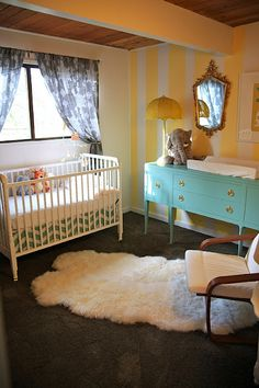 Love the painted buffet used as a changing table....