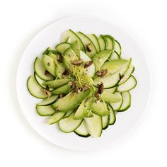 Zucchini Carpaccio Provided By: Create a light summer salad with layers of zucchini and avocado topped with lemon juice for a healthy side dish.
