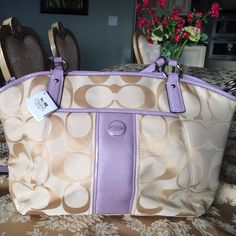 """Beautiful, genuine (NWT) Coach purse. Quality Coach handbag.  Tan with lavender accents, 17"""" wide by 11"""" high.  Brand new with tags.  Steal of a deal!  Many compartments.  Long and short handles. Great for travel or daily use.  Bought for $319, giving it away at &150, exquisite! Coach Bags"""