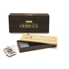 """""""Hand-crafted in beautiful solid hardwood with dark finish, this set offers heirloom quality, and is a great addition to any coffee table or game room. Hand-crafted in beautiful solid hardwood with dark finish, this set offers heirloom quality, and is a great addition to any coffee table or game room. Cribbage is one of the most popular games of the English-speaking world Hand-crafted in beautiful solid hardwood with dark finish Includes stainless steel playing pegs Two decks of playing cards in Most Popular Games, Cribbage Board, Deck Of Cards, Game Room, Card Holder, Decks, Entertaining, Hardwood, Playing Cards"""