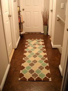 Stenciled drop cloth rug on a brown paper bag floor