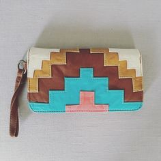 Faux leather wallets w/ wrist strap Description coming soon!  Bags Wallets