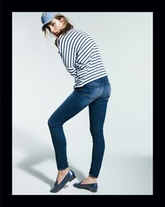 All American classic look - baseball cap, striped top, and comfy denim.
