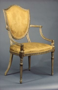 ca. 1790 British Armchair with shield back. Painted and gilt Beechwood.