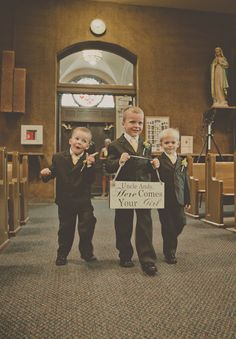 A trio of silly ring bearers walk down the aisle. {Patrick Hadley Photography}