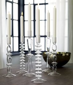 Simple, Elegant Candlesticks  Delicately handblown and heat-tempered strong in clear chem lab beaker glass. Sculptural stacked discs ascend candlelight as modern heirlooms in three light-as-a-feather styles.