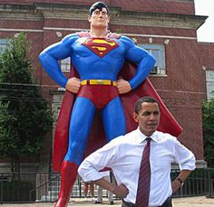 Obama infront of Superman statue