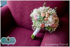 Baby's breath bouquet featuring garden roses, peonies, spray roses, lisianthus, and eucalyptus.