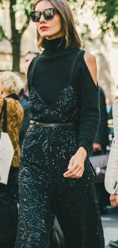 What to Wear on Christmas Eve: A Jazzy Sequined Black Jumpsuit Layered Over a Turtleneck — the perfect mix of casual and cool. // More outfit ideas: (http://www.racked.com/2015/12/22/10437632/holiday-outfits-christmas-eve-last-minute)