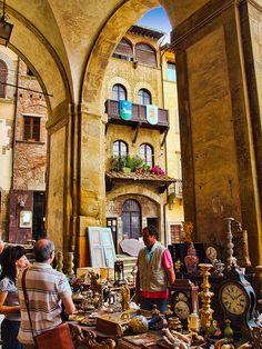 Antiques market in the Loggia of the Piazza Grande, Arezzo, in Italy