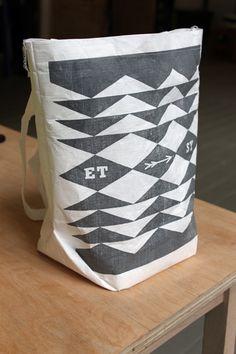 mailing envelope transforms to tote bag