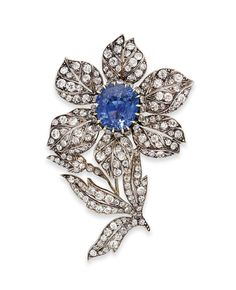 A LATE 19TH CENTURY SAPPHIRE AND DIAMOND BROOCH. Modelled as a flower, the…