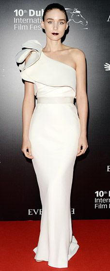 Rooney Mara attends the Oxfam Charity Gala at the 10th Annual Dubai International Film Festival wearing a gorgeous, figure-hugging, sleeveless, one-shoulder gown in white silk, custom-designed by Lanvin.
