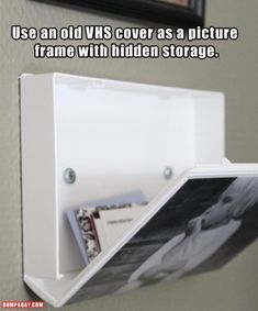 Use an old VHS tape cover for storage and as a picture frame. Good use for all those Disney VHS tape covers!