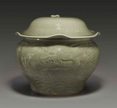A rare Longquan celadon carved jar and cover, Yuan dynasty, 14th century;