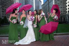 bridesmaids post laughing with umbrellas at post office square  It is creative fun unique interesting photo journalistic documentary wedding photography couples are looking for