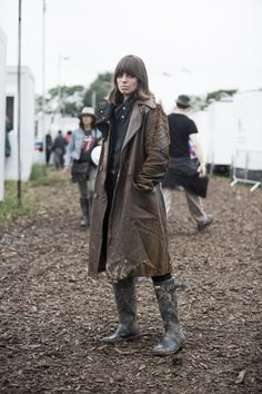 the long raincoat or trenchcoat for a rainy day on a festival, perfect with a pair of rain boots.