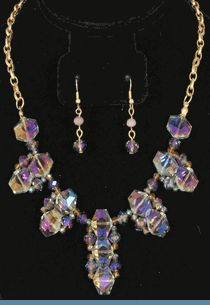 Purple Iridescent Necklace with Earrings Accented with Goldtones $24 @ www.whimzaccessories.com