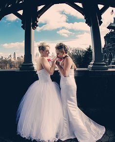 Two Brides - I LOVE their wedding dresses - their personalities in this photo remind me of Lady Gaga! Ultimate USA Gay Weddings LGBT Wedding Planner in New York City