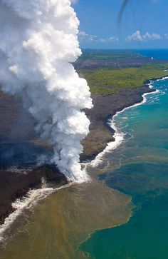 Lava flowing into the ocean with steam plume, The Big Island, Hawaii.