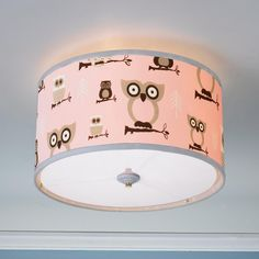 "Owls Drum Shade Ceiling Light This owl drum shade ceiling light will make a fun addition to your home. Great for a baby nursery, kid's room, playroom, or for a whimsical touch in your favorite room. Choose from Pink, Blue or Khaki. Acrylic diffuser. (16""W x 10""H)."