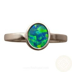 An opal ring with extremely bright Green and Gold colors in a Patch Harlequin pattern. Set in 14k Gold and available in White, Yellow or Rose Gold in any ring size.