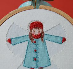 Snow Angel ornament in red and aqua $24 on etsy