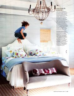 Deborah Needleman's house, Nov. 2011 Martha Stewart Living. Pillows Porthault, ikat bolster Madeleine Weinrib, chandelier and sofa John Derian. I'm eyeing the vaulted ceiling for my bedroom renovation.
