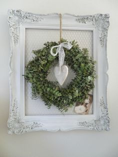 For a vintage Christmas, simply attach a fresh greenery wreath to a weathered antiqued frame and for a sweet touch, an old photo.