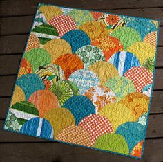Picnic Quilt. Love the fabrics and will have to try this different pattern.