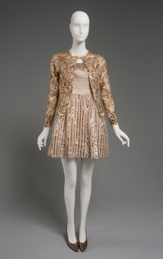 Geoffrey Beene Woman's Ensemble: Dress and Jacket Late 1960s Medium: Dress: beige silk satin, beige silk twill, sheer striped open-weave silk and tinsel, gold sequins; Jacket: beige and gold lace, gold sequins