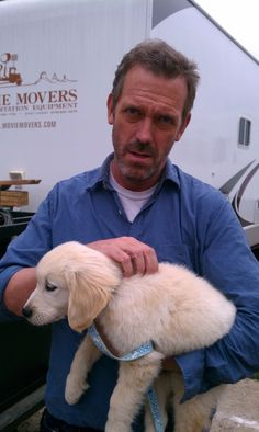 Having a bad day?  Here's the cure.  Hugh Laurie holding a puppy.  Feel better?  Thought so.