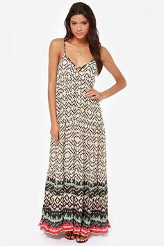 Like a flash of fireworks, the Billabong Brighter Than Black and Beige Print Maxi Dress explodes ...