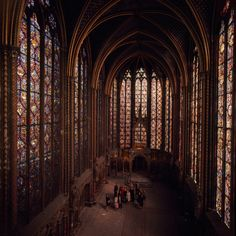 Visitors stare in awe at the stained glass windows of Sainte Chapelle in Paris, May 1968.