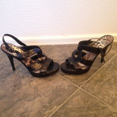"Gianni Bini Black Platform Heels NWOB Black Leather Gianni Bini platform heels with ankle strap. Size: 10M-fits like a 9.5. Heel: 5"" platform: 1"". NWOB. Decluttering my closet. No trades Gianni Bini Shoes Heels"