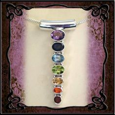 Semi precious stones in a stirling silver pendant corresponding with the chakra points