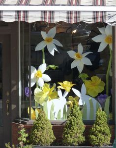 Easter window display at Emily's Garden with paper flowers