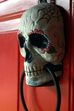 Day of the Dead doorknocker... I just bought one from the Dollar store... you can just DIY and paint it