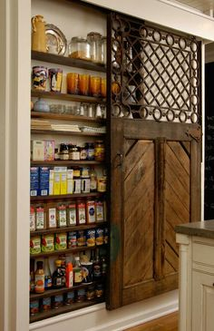 Great idea for a pantry, sunk into the wall with a cool sliding barn style door.