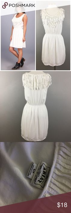 "Ariat White Fringe Boho Country Chic Dress Ariat White Fringe Boho Country Chic Dress. Size small. Dress fully lined and has a stretch waist. Thank you for looking at my listing. Please feel free to comment with any questions (no trades/modeling).  •Fabric: 100% Rayon •Bust: 39"" •Length: 36""  •Condition:  EUC,  no visible flaws.   25% off all Bundles or 3+ items! Reasonable offers welcome. KB Ariat Dresses Mini"