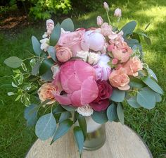 With peonies, roses, ranunculus, stock and more in a color palette of coral, peach, terracotta red and pink.
