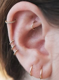 The Coolest Piercings New York Girls Are Getting Right Now #refinery29: anti-tragus, daith, rook, conch, constellation