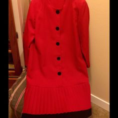 HOST PICK LN-Gorgeous Red Dress. Slimming & Classy 5 BLACK SHINY BUTTONS DOWN THE FRONT OF THIS DRESS ADD CLASS & STYLE. THE PLEATED BOTTOM THAT IS TRIMMED IN BLACK MAKE THIS DRESS STUNNING! EXCELLENT CONDITION. PAIR WITH BLACK PUMPS & YOU WILL LIGHT UP THE ROOM. THIS IS NOT A ORANGE RED BUT MORE OF A CHRISTMAS RED. Dresses Long Sleeve