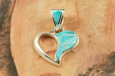 Beautiful Heart Pendant featuring Genuine Sleeping Beauty Turquoise inlaid between ribbons of Sterling Silver. Designed by Navajo Artist Calvin Begay. $99.00