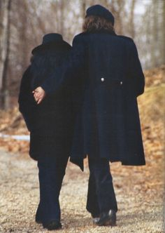 .John & Yoko Ono Lennon taking a stroll in Central Park. When they first came to NYC, there are photo's of the Beatles IN Central Park, near 73rd street. John was looking at the Dakotas for the very first time --- and that would be his home for many years.