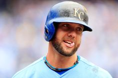 Alex Gordon #4 of the Kansas City Royals smiles after knocking in the game-winning run in the bottom of the 9th inning during the game against the Toronto Blue Jays at Kauffman Stadium on April 14, 2013 in Kansas City, Missouri. (April 13, 2013 - Source: Jamie Squire/Getty Images North America)