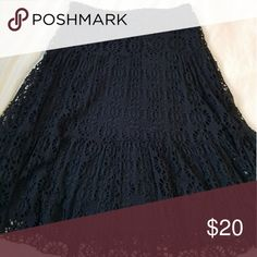 Linda Leal black crocheted skirt This versatile skirt is one that will be used often.  Waist = 14 inches across  Length=24 inches  size Large, but fits like a medium.  Can be worn for a night out with a cute sparkly tank top and your favorite stilettos or for a day around town with ankle booties or sneakers and a denim jacket. Linda Leal Skirts Midi