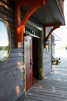 Love the weathered siding, the intense shot of colour and the feeling of a comfortable welcome ...