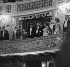 President John Kennedy and President Charles de Gaulle and their wives stand in box in the Louis XV Theater in the Versailles Chateau as the national anthems of France and the U.S. are played prior to a ballet performance.