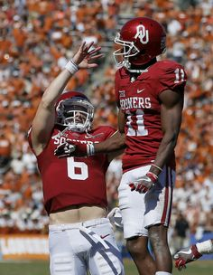 Oklahoma's Baker Mayfield (6) celebrates with Oklahoma's Dede Westbrook (11) after a touchdown during the Red River Showdown college football game between the University of Oklahoma Sooners (OU) and the Texas Longhorns (UT) at Cotton Bowl Stadium in Dallas, Saturday, Oct. 8, 2016. Oklahoma won 45-40. Photo by Bryan Terry, The Oklahoman